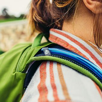 Emplacement zippé pour poche d'hydratation – idéal aussi pour ranger une tablette ou un notebook