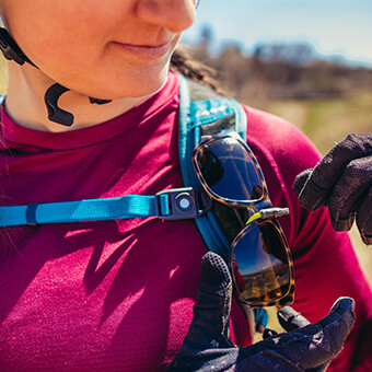 Sunglass QuickStow system on shoulder harness for quick, secure and scratch-free access