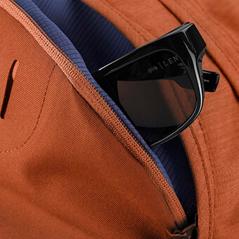 Soft touch zippered pocket for electronics or sunglasses