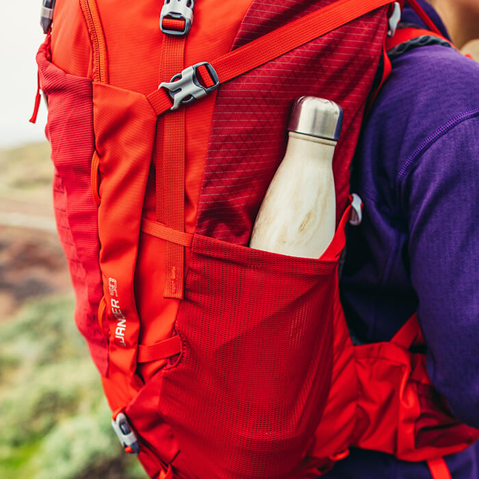 Dual side stretch mesh pockets for easy access to a water bottle