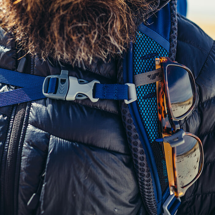 Sunglass QuickStow system - Sunglass QuickStow system on shoulder harness for quick, secure and scratch-free access to  our shades without taking the pack off