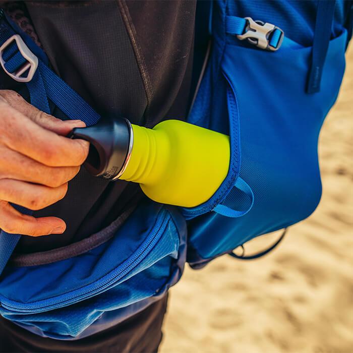Tasche laterali elasticizzate con doppio accesso, comode mentre si è in movimento